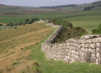 """""""Hadrian's wall at Greenhead Lough"""" by Velella - Personal photograph taken by Velella.. Licensed under Public domain via Wikimedia Commons."""