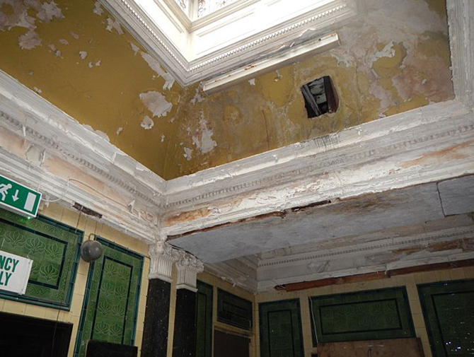 Decorative plaster ceiling in a poor condition due to water damage. Many original features survive from when the building opened in 1880. Image BaRAS