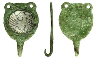 early medieval hooked tag showing an eagle stretching its wings and talons