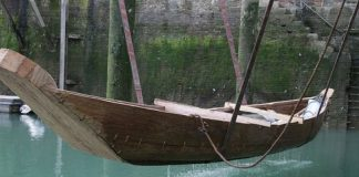 Boat 1550BC is placed into the water at Dover Harbour