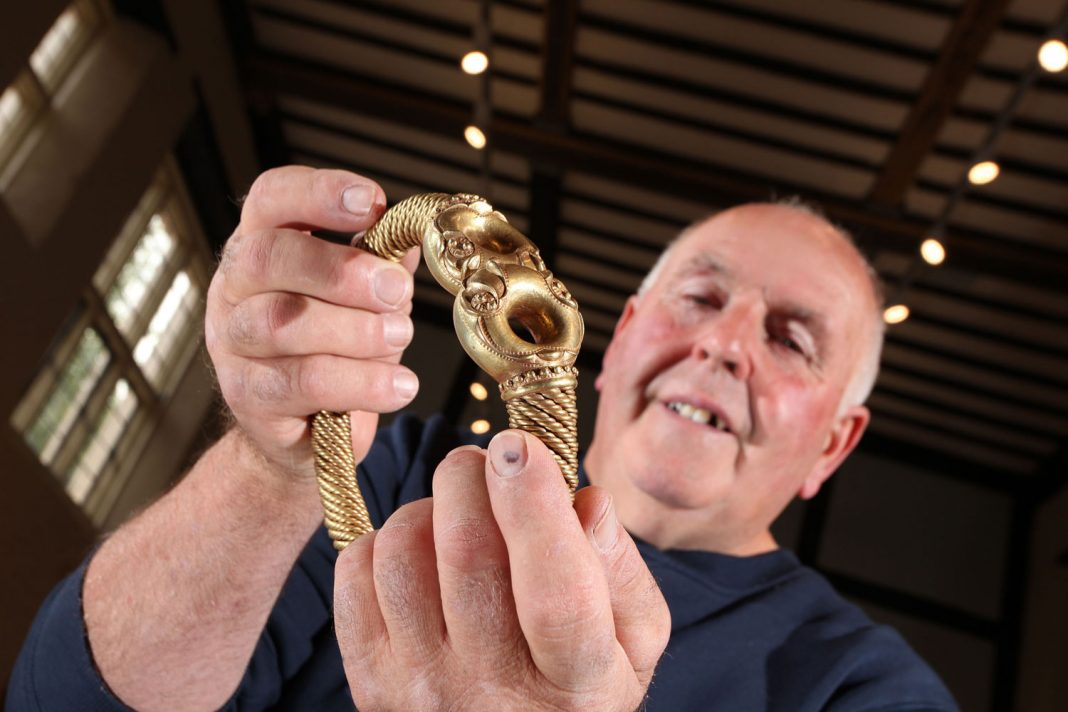 Maurice Richardson holding the Iron Age Torc he discovered in 2005 which has gone on public display just four miles from where it was found. Credit National Civil War Centre/Doug Jackson