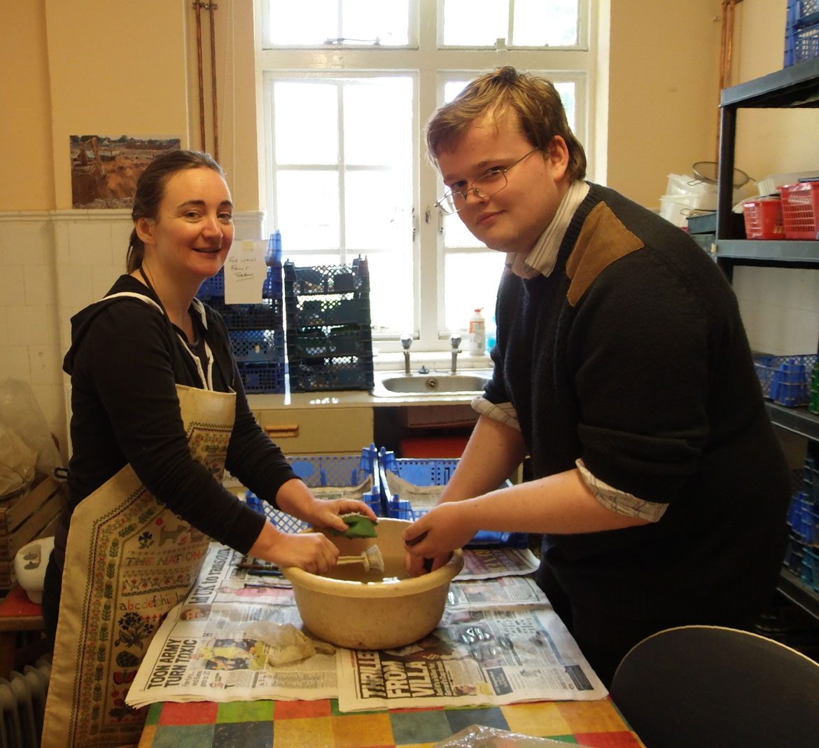 Volunteers clean the pottery from Thaxted. Image: CAT