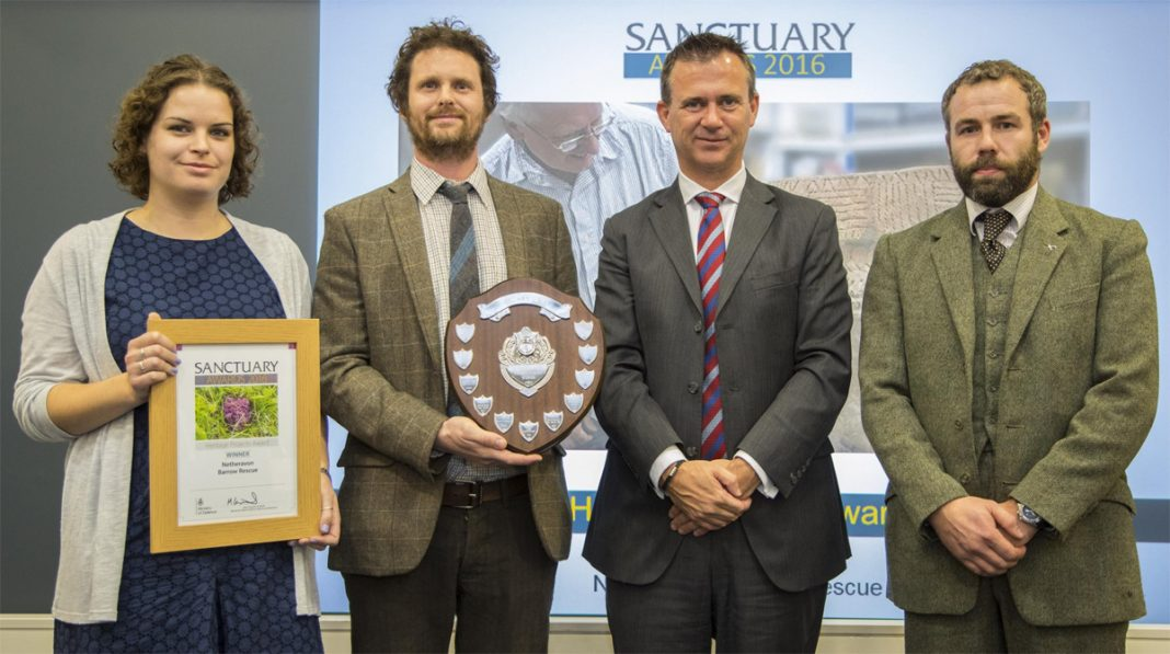 Wessex Archaeology's Jackie McKinley, Phil Andrews and Dave Murdie collect their award from Defence Minister Mark Lancaster Photo: Ministry of Defence