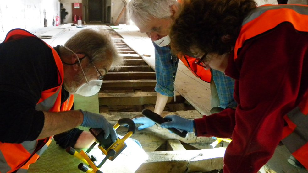 Archaeology volunteers investigate under the floorboards (c) National Trust