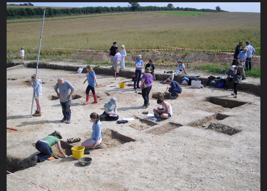 BERTs excavating a host of late Anglo-Saxon features including ditches, pits, post holes and 'beam slots'. (Image: Philip Hill)