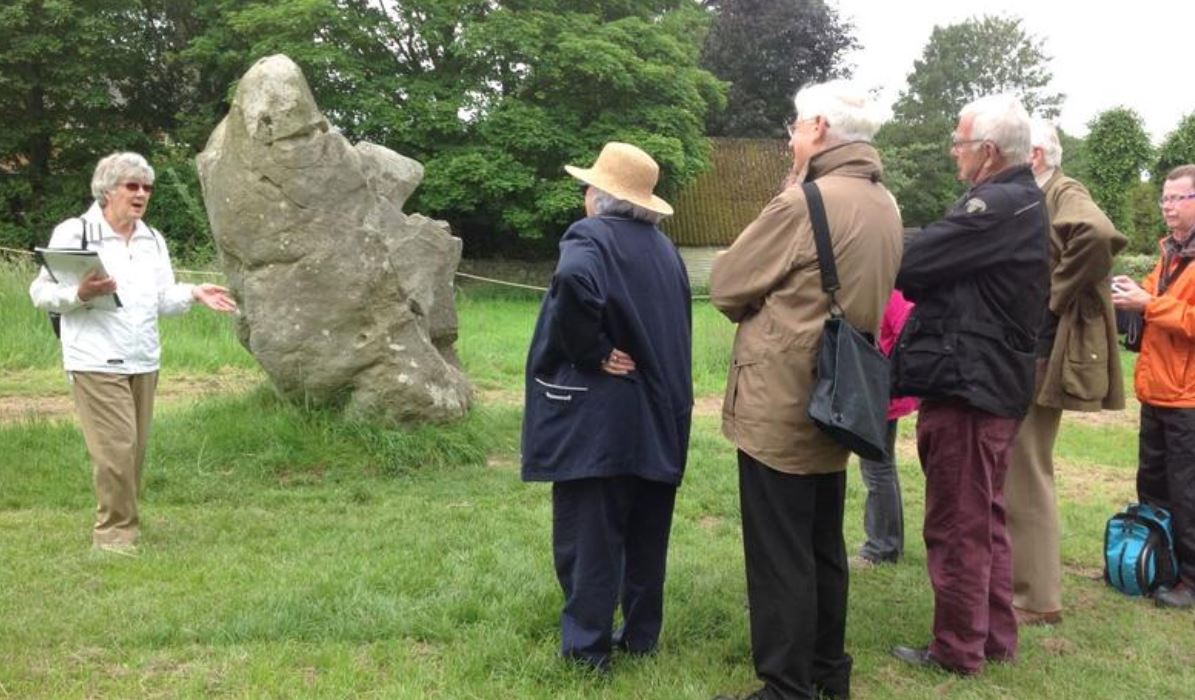 volunteer guides explain the monument: Wessex Archaeology