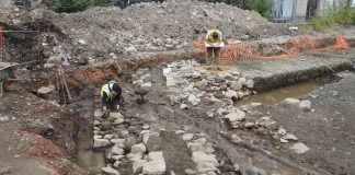 The friary wall being cleaned and recorded by GUARD Archaeologists © GUARD Archaeology Ltd.