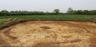 A Middle Iron Age roundhouse with the entrance to the fore, looking north-west. Image: Cotswold Archaeology