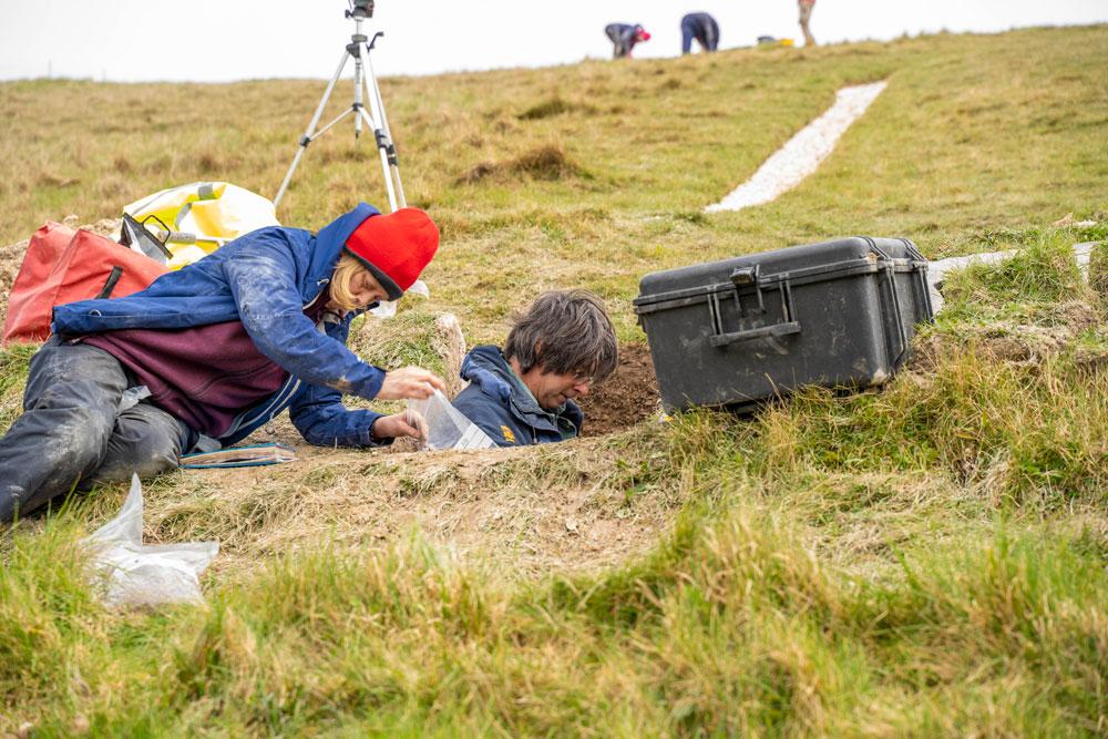 Environmental Archaeologist Mike Allen and archaeologist Julie Gardiner bag up soil samples